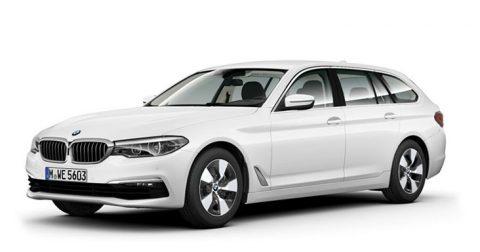 Ein Bild von einem BMW 520d Touring Automatic vor einem weißen Hintergrund.
